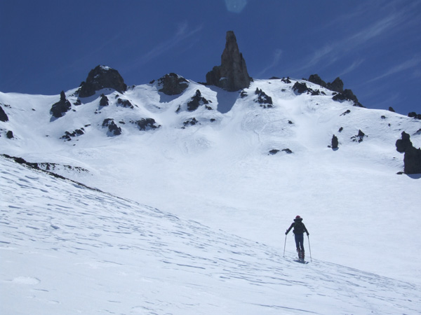 Skinning up towards the rock pinnacle of El Soldado, above Las Leñas,