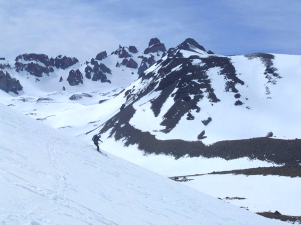 Chris skiing down from the Mirador del Sosneado.